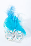 Venetian mask. With blue feathers on white Royalty Free Stock Images
