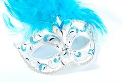 Venetian mask. With blue feathers on white Royalty Free Stock Photos