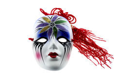 Venetian Mask. Colorful Venetian carnival mask with red hair royalty free stock image