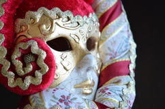 Venetian mask. On a dark background Stock Images