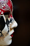 Venetian mask. On a dark background Royalty Free Stock Photos