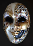 Venetian mask. On a dark background Stock Photography