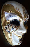 Venetian mask. On a dark background Royalty Free Stock Photo