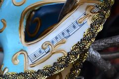 venetian-mask-decorated-with-music-scale Royalty Free Stock Photos