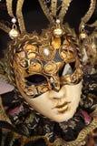 Venetian mask. Golden Hand painted Venetian mask in Venice, Italy Royalty Free Stock Photo