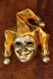 Venetian mask of harlequin. Golden Venetian mask of smiling harlequin