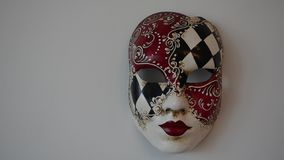 Venetian mask. On a light background stock video footage