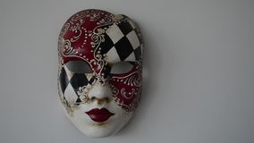 Venetian mask. On a light background stock footage