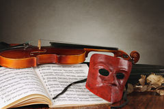 Venetian mask with old fiddle composition Royalty Free Stock Image