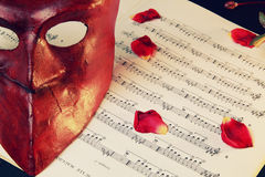 Venetian mask over music score Stock Photos