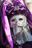 Venetian mask with paiette chrome and purple veil. Royalty Free Stock Images