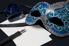 Venetian mask. Traditional venetian mask with pen, ink and paper Stock Images