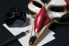 Venetian mask. With pen, ink and paper Stock Image