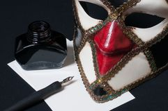 Venetian mask. With pen, ink and paper Royalty Free Stock Photo