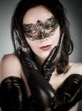 Venetian Mask. A pretty retro girl in black wearing a cute hat a Stock Images