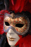 Venetian mask red. Nice traditional mask red and gold stock image
