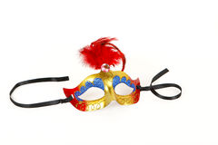 Venetian Mask with Red Feather and Ribbon Stock Photos