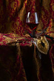 Venetian mask and red wine Royalty Free Stock Images