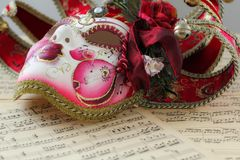 Venetian Mask on a sheet music royalty free stock image