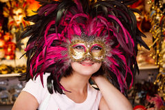 Venetian mask shop. Woman with Venetian mask in the shop Royalty Free Stock Image