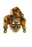 Venetian mask of smiling harlequin. Golden Venetian mask of harlequin isolated on white background
