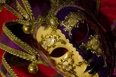 Venetian mask. Venetian theater mask on red Royalty Free Stock Photo