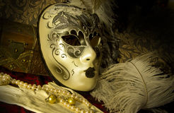 Venetian mask. Venetian theater mask in vintage setting Stock Photo