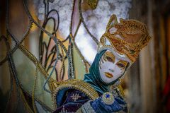 Venetian Masked Model. Masked models  of the Venetian Carnevale Stock Images