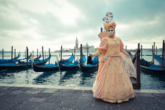Venetian masked model from the Venice Carnival 2015 with Gondola Stock Images