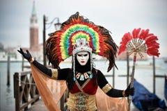 Venetian masked model from the Venice Carnival 2015 Gondola Stock Images