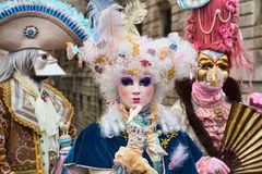 Venetian masked model from the Venice Carnival 2015 with near Plaza San Marco, Venezia, Italy. Traditional venetian masked carnival lady with Casanova in stock images