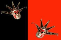 Venetian maskeringar på en svart och en röd bakgrund Arkivbilder