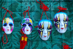 Venetian masks. 4 venetian masks on green background Royalty Free Stock Images