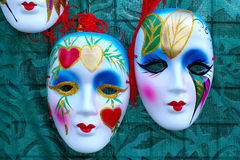 Venetian masks. Two venetian masks on green background Royalty Free Stock Photo