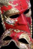 Venetian Masks. Two red venetian masks on a black background Stock Photo