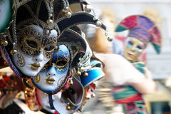 Venetian masks. Row of venetian masks in gold and blue Stock Photos