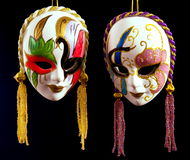Venetian masks. Two Venetian masks of handwork on a dark background Royalty Free Stock Photography