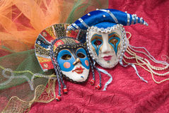 Venetian Masks. Carnival masks on red fabric stock images
