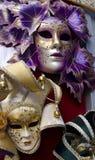 Venetian masks. Beautiful venetian masks in purple and golden color Royalty Free Stock Image