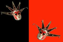 Venetian masks on a black and red background. Stock Images