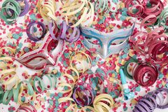 Venetian masks with confetti stock images