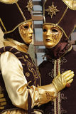 Venetian masks and costumes Stock Images