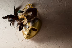 Venetian masks on  old wall Stock Image