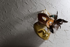 Venetian masks on  old wall Royalty Free Stock Photo
