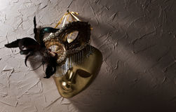 Venetian masks on  old wall Stock Photos