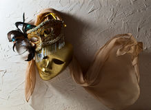 Venetian masks on  old wall Stock Photo