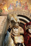 Venetian masks and San Marco church paintings Stock Images