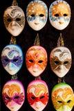 Venetian masks. Small group of generic Venetian masks. Vertical shot, close up Stock Images