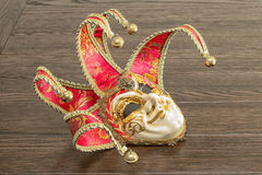 Venetian masks. On wooden table Royalty Free Stock Photography