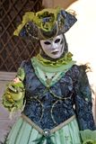 Venetian masquerader (blue) Stock Photography